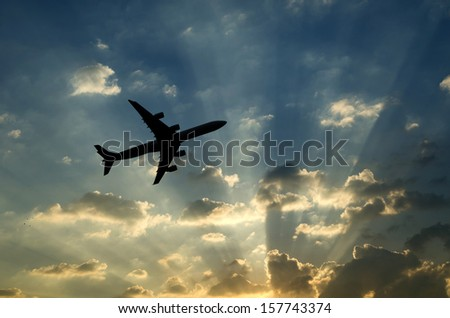Silhouette of an airplane with sunset sky