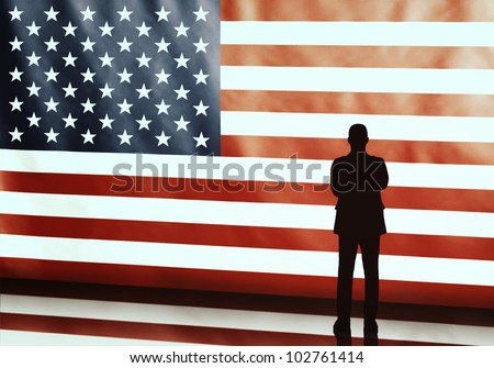Silhouette of an american politician with arms crosses on flag background - stock photo