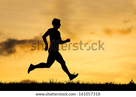 silhouette of an athlete jogging - stock photo