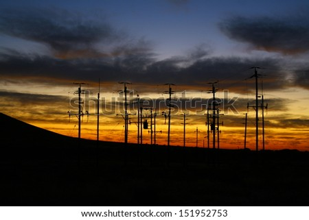Silhouette of an electricity sub-station at dawn in Namibia