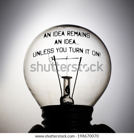 Silhouette of an incandescent light bulb with the message: An Idea remains an idea unless you turn it on! - stock photo