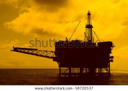 silhouette of an offshore oil rig in coast of Brazil - stock photo