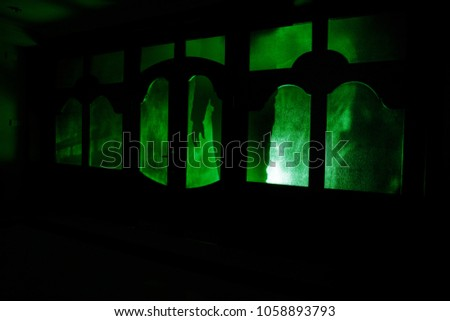Maniac stock images royalty free images vectors shutterstock silhouette of an unknown shadow figure on a door through a closed glass door the planetlyrics Choice Image
