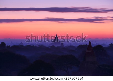 Silhouette of ancient pagode temples with fog after sunrise at Bagan in Myanmar - stock photo