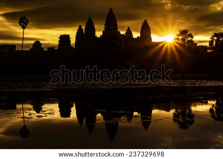 Silhouette of Angkor Wat during sunrise - stock photo