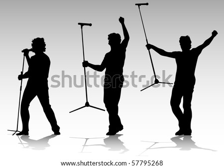 silhouette of artists of hard rock. A live performance on stage - stock photo
