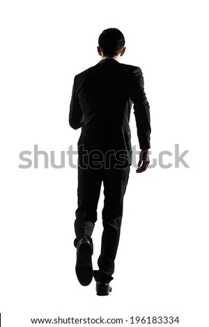 Silhouette of Asian business man running, full length portrait isolated on white. Rear view. - stock photo