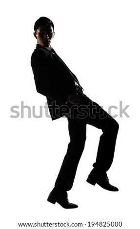 Silhouette of Asian businessman dancing or posing, isolated on white background.