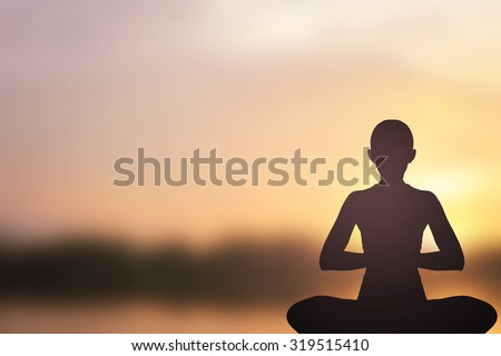 Silhouette of asian woman in yoga over blurred sunset twilight sky backgrounds : asian woman in yoga pattern exercise for healthy life :concentrate woman yoga concept.concentrate and power concept. - stock photo