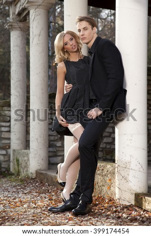 Silhouette of attractive young adult couple in love posing in classic elegance clothes to date - stock photo