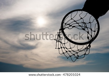 Silhouette of basketball hoop with nice sky background