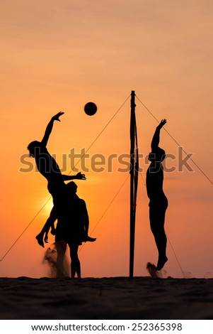 silhouette of beach Volleyball player on the beach and playground sand in sunset