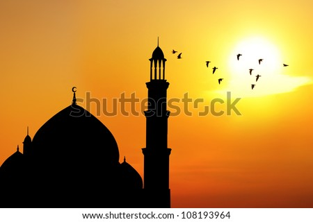 Silhouette of beautiful dome and minaret of mosque. shot at sunset - stock photo