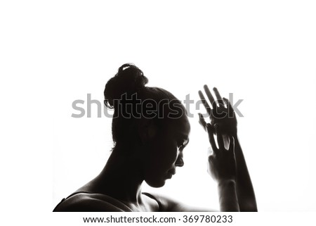 Silhouette of beautiful sensual black woman on a white background