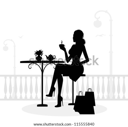 Silhouette of beautiful woman in cafe - stock photo