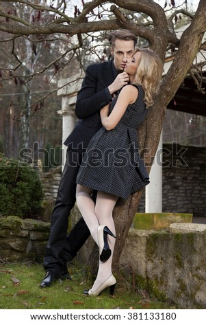 Silhouette of beauty young adult attractive and sensuality couple in love posing in classic elegance clothes to date - stock photo