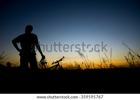 Silhouette of biker at the sunset time