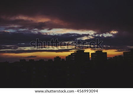 Silhouette of blocks of flats at sunset in Vilnius