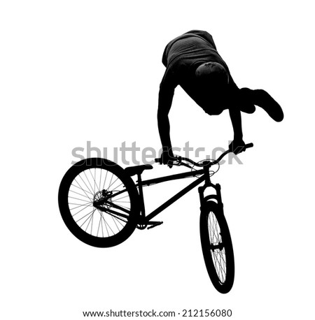 silhouette of bmx riders in action - stock photo