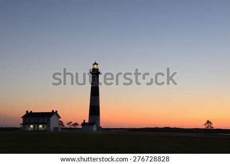 Silhouette of Bodie Lighthouse at Dawn - stock photo