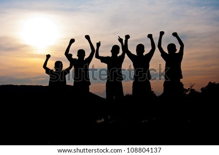silhouette of boy happy and victory  together