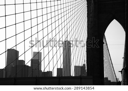 Silhouette of Brooklyn Bridge and Manhattan - stock photo