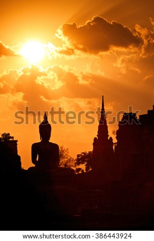 Silhouette of Buddha in a temple at Thailand evening. - stock photo