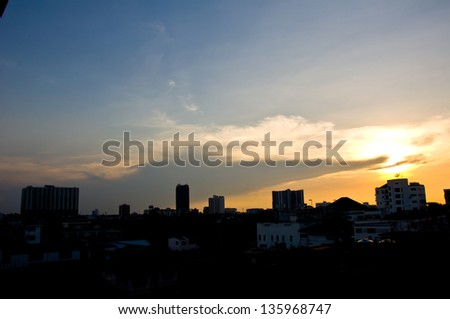 silhouette of building before sundown
