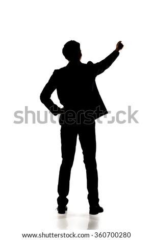Silhouette of business man standing and writing, full length portrait isolated.