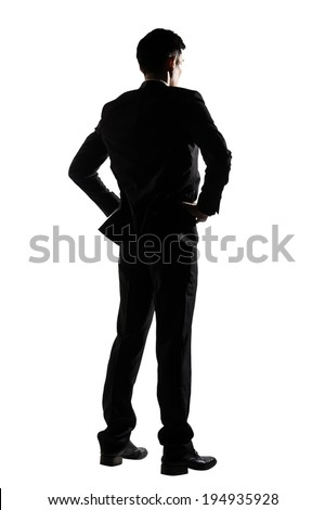 Silhouette of business man standing, full length portrait isolated on white background.