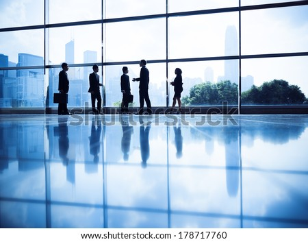 Silhouette of Business People Standing by Water - stock photo