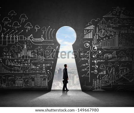 Silhouette of businessman against black wall with key hole - stock photo