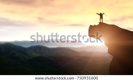 Hiker Standing On Peak Mountain Raised Stock Photo - This man hikes up the transylvanian mountains every morning to photograph sunrise