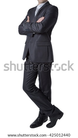 Silhouette of businessman in black suit standing straight put one leg on. On isolated background.