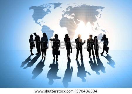 Silhouette of busy business team working in front of world map background - stock photo