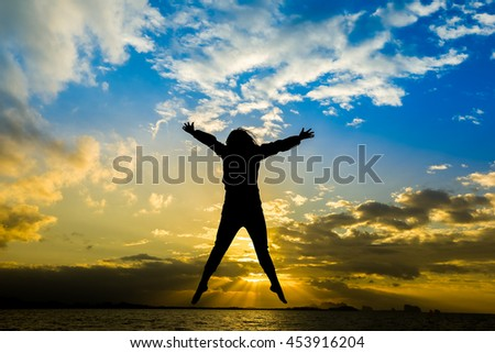 Silhouette of cheering young generation jumping on sunrise beautiful sky background. concept for holiday teenagers celebration freelance victory active together MLM affiliate business program success