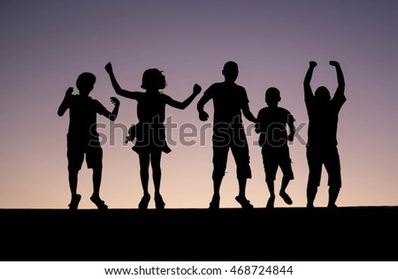 silhouette of children  jumping on abstract  background
