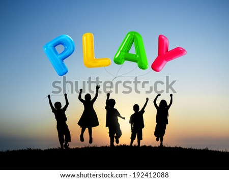 Silhouette of Children Playing Balloons Outdoors - stock photo
