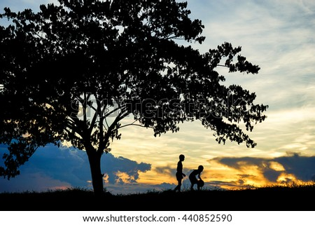 Silhouette of children with ball