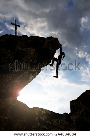 Silhouette of climber at the sunset. - stock photo