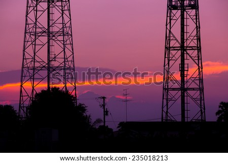Silhouette of communication tower in a wonderful sunrise