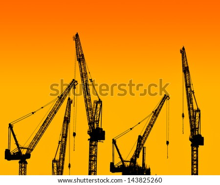 silhouette of construction crane on evening background - stock photo