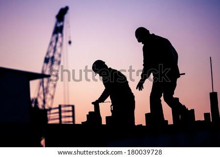 silhouette of construction worker - stock photo