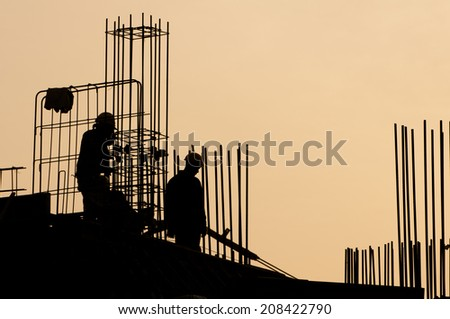 Silhouette of construction worker during sunset