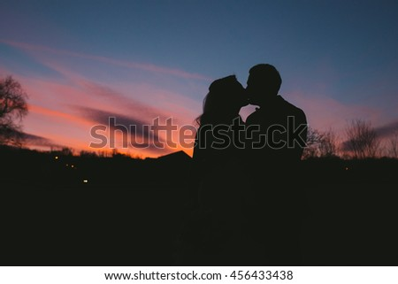 silhouette of couple at beautiful sunset