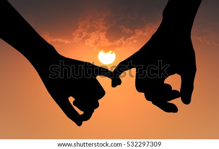 silhouette of couple hooking each others little finger on sunset background hand in hand