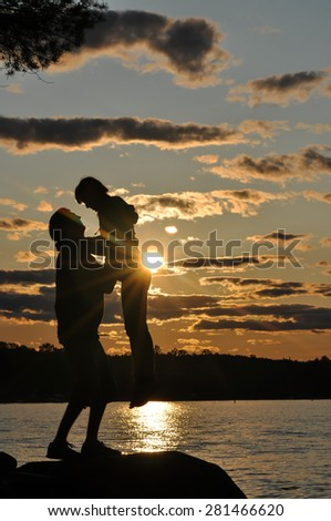 Silhouette of couple in love,Love and sensuality and valentine day concept at lake side  - stock photo