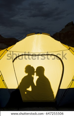 Silhouette of couple kissing in tent & Silhouette Couple Kissing Tent Stock Photo 647255506 - Shutterstock