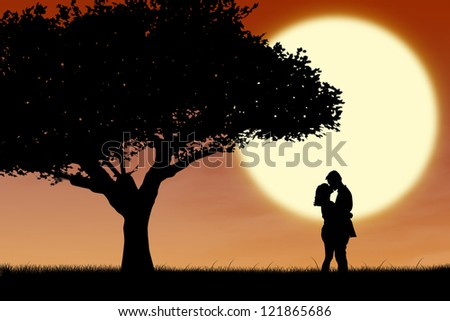 Silhouette of couple kissing in the park on sunset