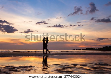 silhouette of couple on sunset beach, beautiful background about love and relationships, man and woman